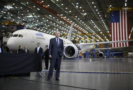 Boeing CEO Jim McNerney waits to be introduced to speak, in front of a Boeing 787 Dreamliner under construction as U.S. President Barack Obama (not pictured) toured the Boeing facility in Everett, Washington February 17, 2012. REUTERS/Jason Reed