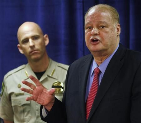 Pinal County Sheriff Paul Babeu (L) listens as Arizona Attorney General Tom Horne speaks about weapons and drugs seized from the Mexican Sinaloa cartel during ''Operation Pipeline Express'' at a news conference in Phoenix, Arizona October 31, 2011. REUTERS/Joshua Lott