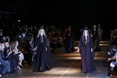 Models present creations by French designer Hedi Slimane as part of his Spring/Summer 2013 women's ready-to-wear fashion show for French fashion house Saint Laurent Paris during Paris fashion week October 1, 2012. REUTERS/Gonzalo Fuentes