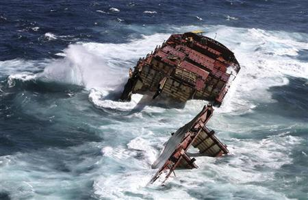 The bow section of the stricken container ship Rena remains above water about 14 nautical miles (22 km) from Tauranga on the east coast of New Zealand's North Island, in this April 4, 2012 handout picture. REUTERS/Maritime New Zealand/Handout