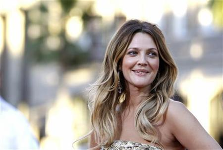 Cast member Drew Barrymore poses at the premiere of ''Going the Distance'' in Hollywood, California August 23, 2010. REUTERS/Mario Anzuoni