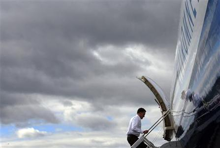 Republican presidential candidate and former Massachusetts Governor Mitt Romney boards his campaign plane in Bedford, Massachusetts October 1, 2012. REUTERS/Brian Snyder