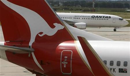 Two Qantas passenger jets are seen on the tarmac at Melbourne's Tullamarine Airport December 16, 2009. REUTERS/Mick Tsikas