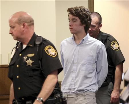 Chardon High School suspected gunman TJ Lane (C) is escorted into court for his court appearance, by Sheriffs deputies in Chardon, Ohio May 24,2012. REUTERS/Aaron Josefczyk