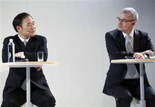 Zhejiang Geely Holding Group Chairman Li Shufu (L) and Volvo CEO Stefan Jacoby look at each other during the Volvo Cars China Business Strategy Launch in Beijing in this February 25, 2011 file photograph.REUTERS/Christina Hu/Files