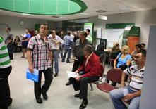 People are seen in a government-run employment office in the Andalusian capital of Seville October 2, 2012. REUTERS/Marcelo del Pozo