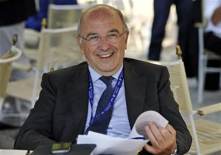 European Union Competition Commissioner Joaquin Almunia smiles during the Ambrosetti workshop, an international economic meeting, in Cernobbio September 9, 2012. REUTERS/Paolo Bona