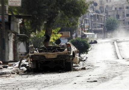 A destroyed vehicle is seen in Aleppo's al-Zebdieh district, after the area was shelled, October 1, 2012. Picture taken October 1, 2012. REUTERS/Zain Karam