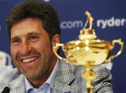 European Ryder Cup captain Jose Maria Olazabal smiles during a news conference in a hotel near Heathrow Airport, in west London October 2, 2012. REUTERS/Luke MacGregor