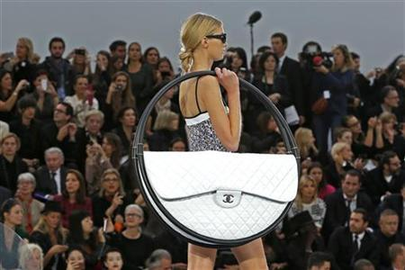 A model presents a creation by German designer Karl Lagerfeld for French fashion house Chanel as part of his Spring/Summer 2013 women's ready-to-wear fashion show during Paris fashion week October 2, 2012. REUTERS/Charles Platiau