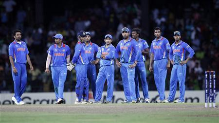 India's players stand on the field after a dismissal decision was reversed and South Africa's Robin Petersen returned to the crease during their Twenty20 World Cup Super 8 cricket match in Colombo October 2, 2012. REUTERS/Dinuka Liyanawatte
