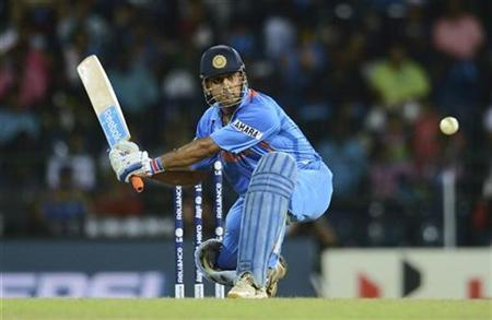Mahendra Singh Dhoni hits out during the ICC World Twenty20 Super 8 cricket match against South Africa at the R Premadasa Stadium in Colombo October 2, 2012. REUTERS/Philip Brown