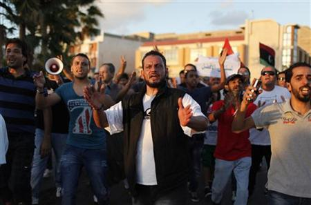 Protesters chant anti-armed militias slogans during a march in Benghazi city, September 21, 2012. REUTERS/Asmaa Waguih