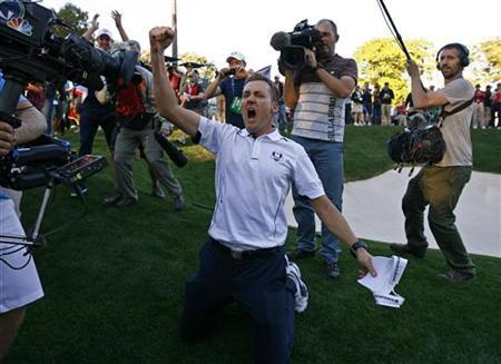 Team Europe golfer Ian Poulter of England celebrates winning the Ryder Cup for Europe during the 39th Ryder Cup singles golf matches at the Medinah Country Club in Medinah, Illinois, September 30, 2012. REUTERS/Matt Sullivan