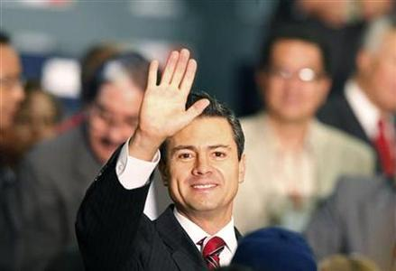 Mexico's President-elect Enrique Pena Nieto waves to the crowd as he arrives for the ''Coalicion Mexico por los derechos de las personas con discapacidad'' (Mexico Coalition for the Rights of Persons with Disabilities) event in Mexico City September 25, 2012. REUTERS/Bernardo Montoya