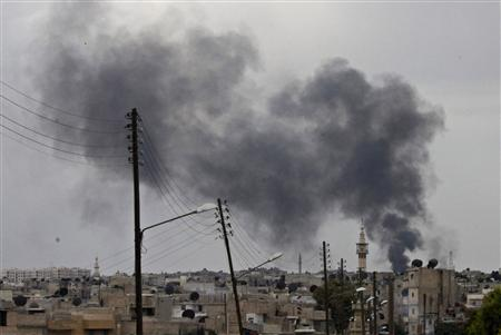 Smoke rises after an air strike on the city of Aleppo October 2, 2012. REUTERS/Zain Karam