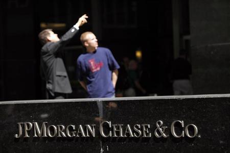 People look at the JP Morgan headquarters in New York, May 17, 2012. REUTERS/Eduardo Munoz