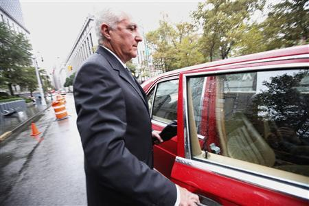 Former Madoff employee Daniel Bonventre exits the Manhattan Federal Court in New York October 2, 2012. U.S. prosecutors added new charges against former operations manager Daniel Bonventre, former investment advisory employees Annette Bongiorno and Joann Crupi, and former computer programmers Jerome O'Hara and George Perez in an indictment that dates the Madoff company's conspiracy to defraud clients to roughly two decades earlier than previously alleged. REUTERS/Brendan McDermid