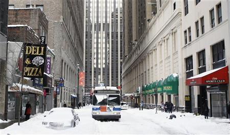 A bus sits stuck on a side street in Manhattan after a snow storm in New York December 27, 2010. REUTERS/Lucas Jackson