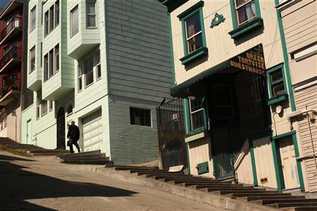 A man climbs a set of stairs built into the sidewalk in the North Beach neighborhood in San Francisco, California May 27, 2012. REUTERS/Robert Galbraith