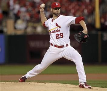 St. Louis Cardinals starting pitcher Chris Carpenter delivers a pitch to a Cincinnati Reds batter during the first inning of their MLB National League baseball game in St. Louis, Missouri, October 2, 2012. REUTERS/Sarah Conard