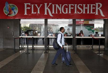 A passenger walks past a near-empty Kingfisher airlines ticketing office at Mumbai's domestic airport in this March 27, 2012 file photo. REUTERS/Vivek Prakash/Files