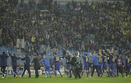 BATE Borisov's players, staff and supporters celebrate victory over Bayern Munich after their Champion's League Group F soccer match in Minsk's Dinamo Stadium October 2, 2012. REUTERS/Vasily Fedosenko