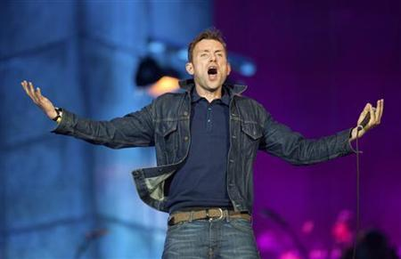 Damon Albarn from British band Blur performs as part of the London 2012 Olympic Games closing celebrations at Hyde Park, London, August 12, 2012. REUTERS/Ki Price