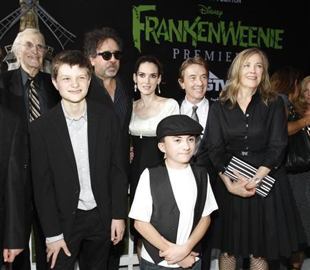 Director and producer Tim Burton (3rd L) poses with cast members (from L-R) Martin Landau, Charlie Tahan, Winona Ryder, Atticus Shaffer, Martin Short and Catherine O'Hara at the premiere of ''Frankenweenie'' at El Capitan theatre in Hollywood, California September 24, 2012. The movie opens in the U.S. on October 5. REUTERS/Mario Anzuoni