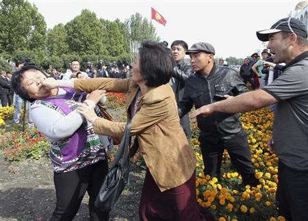 Participants fight during an opposition rally in Kyrgyzstan's capital Bishkek October 3, 2012. REUTERS/Vladimir Pirogov