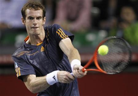 Andy Murray of Britain hits a return to Lukas Lacko of Slovakia during their men's singles match at the Japan Open tennis championships in Tokyo, October 3, 2012. REUTERS/Yuriko Nakao