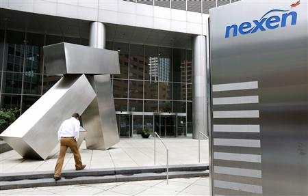 A man walks into the Nexen building in downtown Calgary, Alberta, in this July 23, 2012, file photo. Canada's main opposition party urged the Conservative government not to rubber-stamp a bid by China's CNOOC Ltd to buy oil company Nexen Inc without public consultations, saying opinion had hardened against the deal, on October 2, 2012. REUTERS/Todd Korol/Files