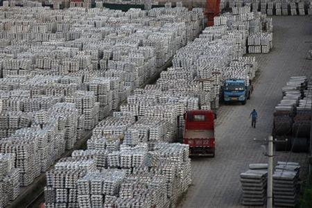 A worker walks through an aluminium ingots depot in Wuxi, Jiangsu province September 26, 2012. REUTERS/Aly Song