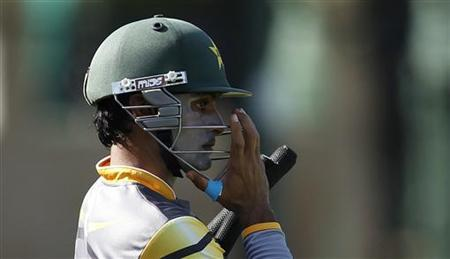 Pakistan's captain Mohammad Hafeez adjusts his helmet during a practice session ahead of their Twenty20 World Cup semi-final match against Sri Lanka in Colombo, October 3, 2012. REUTERS/Dinuka Liyanawatte