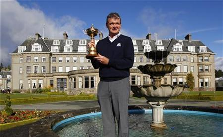Europe Ryder Cup team golfer Paul Lawrie poses with the Ryder Cup during a photocall in front of the Gleneagles Hotel, the venue for the 2014 Ryder Cup, in Scotland October 3, 2012. The photocall officially started the countdown for Ryder Cup 2014 at Gleneagles. REUTERS/David Moir