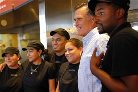 Republican presidential candidate and former Massachusetts Governor Mitt Romney poses for a photograph with workers at a Chipotle Restaurant in Denver, Colorado October 2, 2012 ahead of his first debate with U.S. President Barack Obama. REUTERS/Brian Snyder