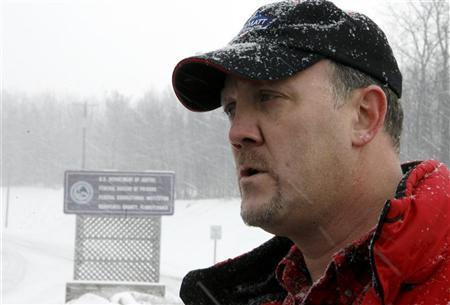 Bradley Birkenfeld listens to a reporter's question before surrendering to authorities at the Schuylkill County Federal Correctional Institution in Minersville, Pennsylvania, January 8, 2010. REUTERS/Tim Shaffer