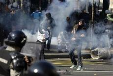 Anti-gay protesters throw stones towards riot policemen during clashes in Belgrade October 10, 2010. REUTERS/Marko Djurica