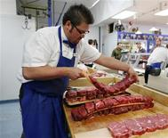 Clayton Colliou, a butcher at Bon Ton Meat Market, works with choice cuts of Alberta beef in Calgary, Alberta, October 3, 2012. Bon Ton stated it was not effected by the recent E.Coli outbreak as they get their meat from select smaller producers. E. coli, a strain of which can cause sickness or even death, is widely present in meat-processing plants, and regulators require packers to control the bacteria within certain levels. E.coli can be killed by thoroughly cooking meat. REUTERS/Todd Korol