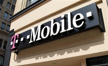 Signage for a T-Mobile store is pictured in downtown Los Angeles, California in this August 31, 2011, file photo. REUTERS/Fred Prouser/Files