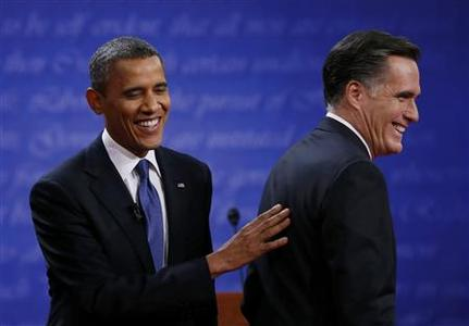 President Barack Obama (L) and Republican presidential nominee Mitt Romney share a laugh at the end of the first presidential debate in Denver October 3, 2012. REUTERS/Jim Bourg
