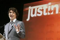Liberal Member of Parliament Justin Trudeau gestures as he announces his run for the leadership of the Liberal party at a rally in Montreal, October 2, 2012. REUTERS/Christinne Muschi