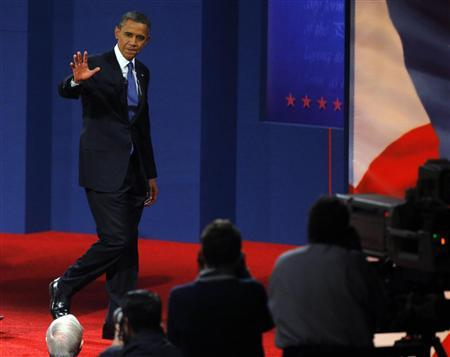 U.S. President Barack Obama walks offstage following the first 2012 U.S. presidential debate with Republican presidential nominee and former Massachusetts Governor Mitt Romney in Denver October 3, 2012. REUTERS/Brian Snyder