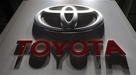 A logo is seen on the Toyota booth on media day at the Paris Mondial de l'Automobile September 27, 2012. REUTERS/Christian Hartmann