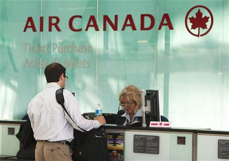 A man checks into an Air Canada flight at the Toronto Pearson International Airport in Toronto, September 20, 2011. REUTERS/Mark Blinch