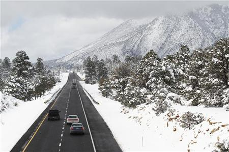 Motorists travel westbound along Interstate 40 after several inches of snow fell during a winter storm in Flagstaff, Arizona March 19, 2012. REUTERS/Joshua Lott
