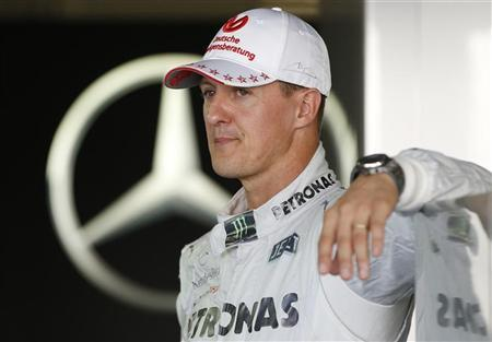 Mercedes Formula One driver Michael Schumacher of Germany stands in his garage at the Suzuka circuit October 4, 2012, ahead of Sunday's Japanese F1 Grand Prix. REUTERS/Toru Hanai