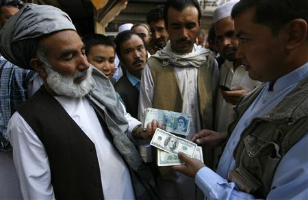 Afghan money changers gather to deal with foreign currency at a money change market in Herat October 4, 2012. REUTERS/Mohammad Shoiab