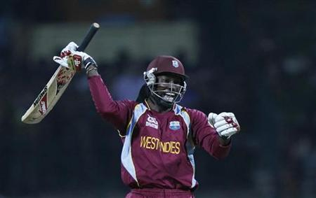 West Indies' Chris Gayle celebrates after the West Indies defeated New Zealand following a super over in their Twenty20 World Cup Super 8 cricket match in Pallekele October 1, 2012. REUTERS/Dinuka Liyanawatte