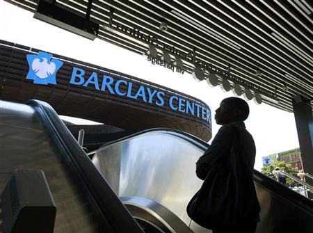 A woman exits the subway outside the new Barclays Center in the Brooklyn borough of New York September 21, 2012. REUTERS/Brendan McDermid